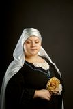 Medieval woman with flower Royalty Free Stock Photography