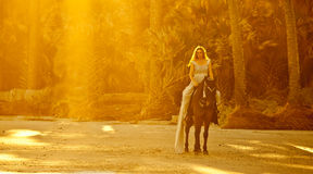 Medieval woman on horseback. Medieval woman in formal dress on horseback on beach Royalty Free Stock Photo