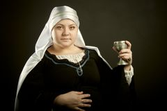 Medieval woman with goblet Stock Images