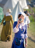 Medieval woman having a drink Royalty Free Stock Photos