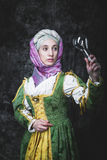 Medieval woman holding an electric lamp Royalty Free Stock Photography