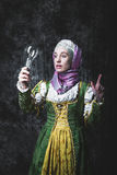 Medieval woman holding an electric lamp Stock Photo
