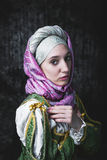 Medieval woman holds a Catholic cross. Royalty Free Stock Image