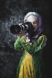 Medieval woman holds SLR camera Stock Photos