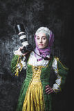 Medieval woman holds SLR camera Royalty Free Stock Images