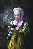 Medieval woman holds SLR camera Royalty Free Stock Photography