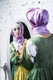 Medieval woman is looking in mirror Royalty Free Stock Photos