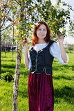 Medieval woman near the birch Royalty Free Stock Image