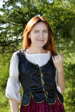 Medieval woman near the fir Royalty Free Stock Photos