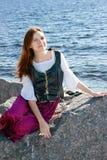 Medieval woman near the sea Royalty Free Stock Photos
