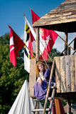 Medieval woman resting in the guard-house Stock Image