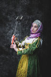 Medieval woman Self holding stick Royalty Free Stock Photo