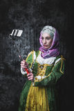 Medieval woman Self holding stick Royalty Free Stock Image