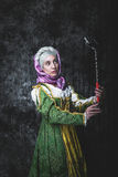 Medieval woman Self holding stick Stock Images