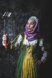 Medieval woman Self holding stick Stock Photos