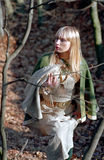 Medieval woman walking in forest Royalty Free Stock Photography