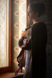 Medieval woman. Young woman pose in a medieval castle Royalty Free Stock Image