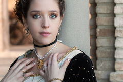 Medieval woman. Young woman pose in a medieval castle stock photography