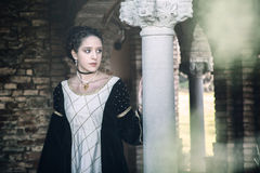Medieval woman. Young woman pose in a medieval castle Stock Photos