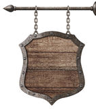 Medieval wood sign or shield hanging on chains isolated