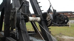 Medieval wooden catapult exhibits at open air history museum, military equipment. Stock footage stock video