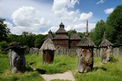 Medieval wooden church with old apiary,Ukraine,Pirogovo,Europe Royalty Free Stock Photos