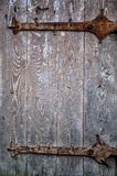 Medieval wooden door with hardware elements Royalty Free Stock Photo