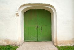 Medieval wooden door painted in green Royalty Free Stock Photo