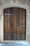Medieval Wooden Door. Picture of a restored medieval wooden door with metal hinges and door knob stock photography