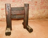 Medieval wooden guillotine. Medieval instrument of torture . Stock Photo