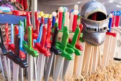 Medieval Wooden swords and helmet. Children shop, toys Stock Image