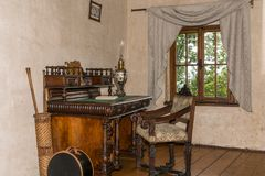 Medieval writing table with chair. By the window stock images