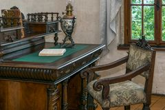Medieval writing table with chair. By the window stock photo