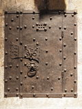 Medieval wrought iron door in a sand stone wall. Germany 2016 Stock Images