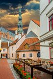 Medieval yard and Church of Saint Peter in old Riga Stock Photos