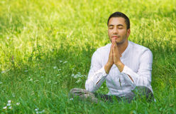 Medieval young man praying Stock Photography