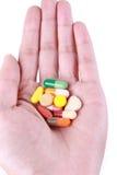 medikamentet gömma i handflatan Royaltyfri Fotografi