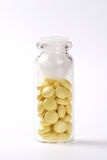 Medikation, gelbe Tablette Lizenzfreie Stockbilder