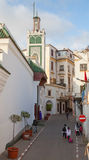 Medina area in Tangier, Morocco. People are walking on narrow street Stock Photos