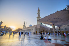 MEDINA, SAUDI ARABIA (KSA) - MARCH 21: SUnset at Nabawi Mosque. MEDINA, SAUDI ARABIA (KSA) - MARCH 21: Muslims get ready to pray inside Nabawi Mosque March 21 Royalty Free Stock Image