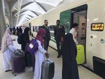 Free MEDINA, SAUDI ARABIA - MAY 27, 2019 :  A Group Of Muslim Family Ready To Embark Train Coaches At HSR Madinah Station In Medina, Royalty Free Stock Images - 150365659