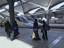 Free MEDINA, SAUDI ARABIA - MAY 27, 2019 :  A Group Of Women In Black Abayas Ready To Embark Train Coaches At HSR Madinah Station In Stock Photography - 150365762