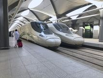 Free MEDINA, SAUDI ARABIA - MAY 27, 2019 :  An Unidentified Muslim Pilgrim Man In White Ihram Clothes Ready To Embark Train Coach At Stock Photos - 150365663