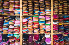Medina souk Fez, artisan shop of leather sleepers babouche,Fez,Morocco. Stock Photos