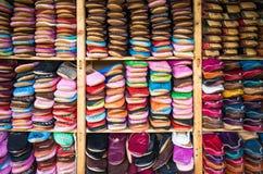 Medina souk Fez, artisan shop of leather sleepers babouche,Fez,Morocco. Stock Photos