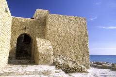 Medina- Tunisia. Entrance to the 15th century medina (built by the Hafsids on an existing 9th century Aghlabid site) in the coastal tourist town of Hammamet on Royalty Free Stock Photography