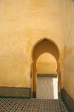 Medina wall with door. Yellow wall with arc, Morocco, Meknes Stock Photos