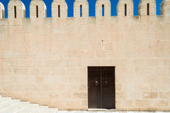 Medina Wall with Door (1). Fortified Wall around Tunsian Old Town with Entrance Door Royalty Free Stock Photos