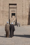 Medinet Habu. Luxor, Egypt - April 16, 2008: Some local Egyptains caretaker walking through the Hypostyle Hall of Medinet Habu, Luxor.The ancient Egyptian name Royalty Free Stock Images