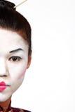 Medio geisha de la cara del primer Imágenes de archivo libres de regalías